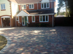 Sweeping driveway and curb edging